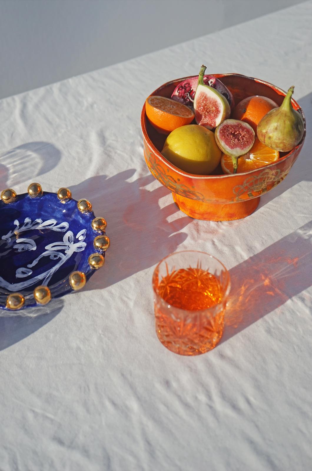 alagonda-schaal-op-voet-orange-glas
